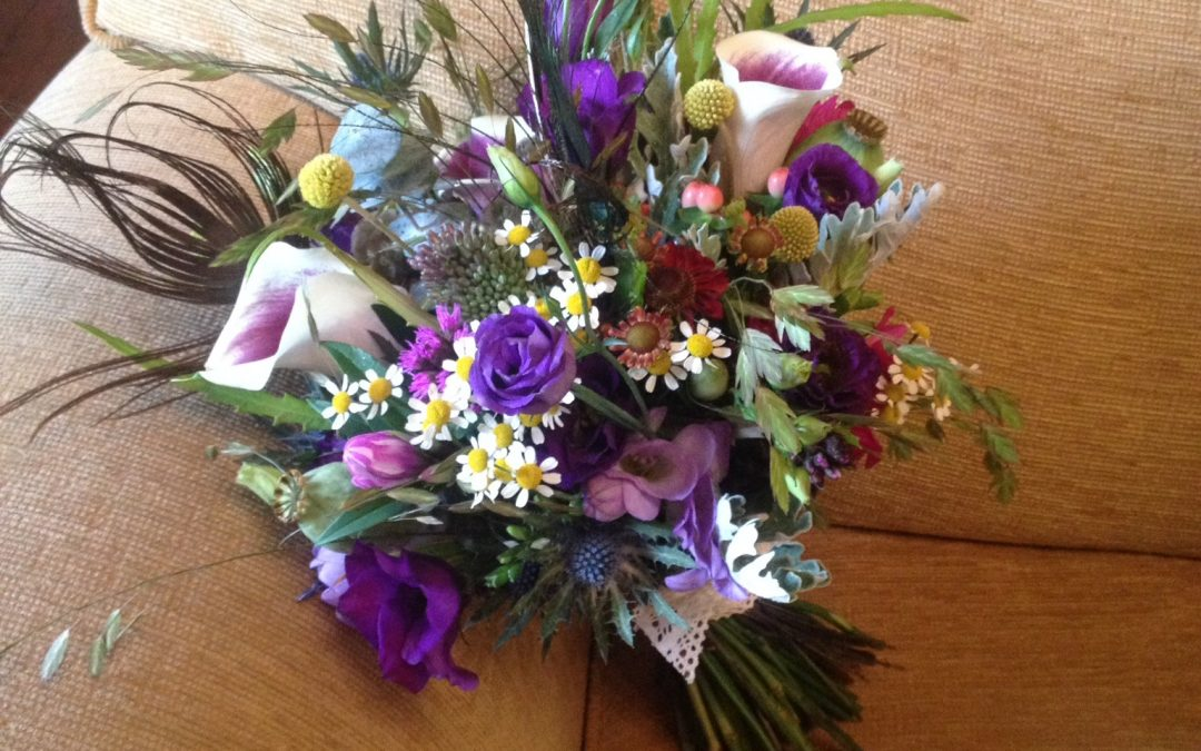 Meadow style wedding flowers at Clearwell Castle